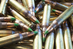 Rifle shells with green tipped bullets Royalty Free Stock Images