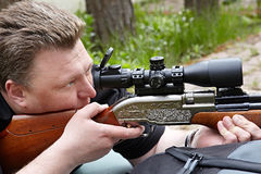 Rifle shooting with optical sight stock images