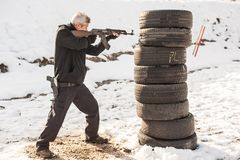 Rifle tactical shooting training behind and around cover or barricade. Rifle combat shooting training from behind and around cover or barricade. Advanced stock photo