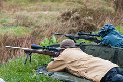 Rifle target shooters aiming. Castlemaine, Ireland - 28th March 2015: Rifle target shooting at Castlemaine gun range, Target shooting has grown popularity in Royalty Free Stock Images