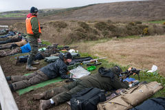 Rifle target shooters. Castlemaine, Ireland - 28th March 2015: Rifle target shooting at Castlemaine gun range, Target shooting has grown popularity in Ireland Royalty Free Stock Photo
