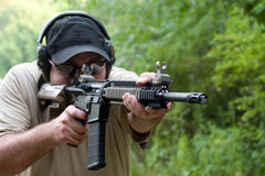 Rifle Training with .223 Caliber. Man at an outdoor wooded range training or practicing with a .308 caliber precision rifle Stock Photo