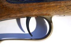Rifle Trigger. A trigger on an old wood black powder firearm stock photography