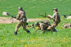 Riflemen attack. LOSHANY, BELARUS - MAY 9: military history club members in Soviet WWII uniform attack enemy positions during historical reenacting show at Stock Images