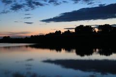 Riflessione dell'acqua durante il tramonto Fotografia Stock