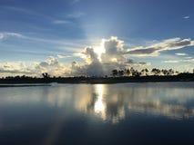 Riflessione di un tramonto sopra i terreni paludosi dopo una tempesta Fotografia Stock Libera da Diritti