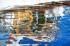 Riflessione di una barca in un porto Fotografia Stock
