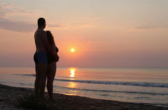 Riflessione pacifica dell'acqua della spiaggia di alba Immagine Stock Libera da Diritti