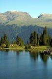 Riflessione sul lago Colbricon Immagini Stock