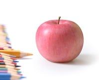 Rifornimenti ed Apple di banco Fotografia Stock