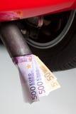 Rifornisca lo spreco di combustibile di soldi Fotografia Stock