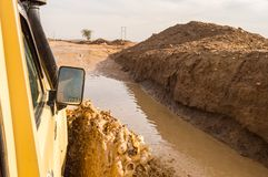 Passage through the mud with a jeep on the track in Kenya`s rift. Rift,Kenya,Afrique-03/01/2018.Passage through the mud with a jeep on the track in Kenya`s rift royalty free stock image