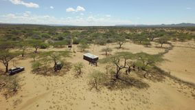 Rift valley tribal gathering hut in African savannah in dry season stock footage
