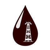 Rig in a drop of oil. Royalty Free Stock Image