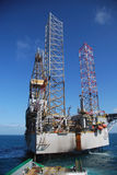 Rig move of an Jack-up rig. Rig move of an grey Jack-Up rig in the North Sea Stock Photography