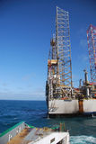 Rig move of an Jack-up rig. Rig move of an grey Jack-Up rig in the North Sea Royalty Free Stock Photography