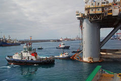 Rig move of an Semi submersible drilling rig. Several tug boats engaged in rig move of an semi submersible drilling rig from Las Palmas Royalty Free Stock Photos