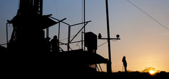 Rig in sun. Workers working at oil rig Stock Image