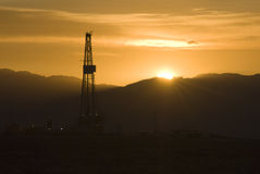 Rig at sunrise. Oil and gas drilling rig at sunrise in Wyoming Stock Photos