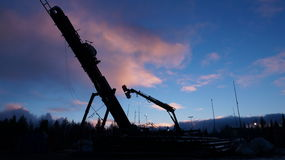 Rig. Well.Sunset on the rig. North of Russia royalty free stock photography