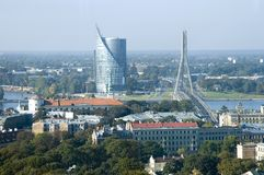 Riga. Kind on bank and the bridge from hotel Latvia Royalty Free Stock Photography