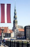 Riga. Sacred Peter's cathedral and flag of Latvia Stock Photography