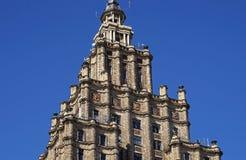 Riga akademi av den vetenskapsStalin skyskrapan, symboler Royaltyfri Foto