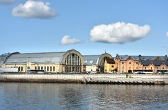 Riga Centralmarket at river banks of Daugava. Central market in Riga at the river banks of Daugava, Latvia. The market is located in the old zeppelin halls stock images