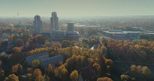 Riga city Autumn buildings living houses Drone flight sunny day. Autumn buildings in the Town Drone flight houses blocks of flats, sunshine flight stock footage