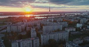 Riga city Autumn buildings living houses Drone flight sunny day TV tower sunset. Autumn buildings in the Town Drone flight houses blocks of flats, sunshine stock video footage