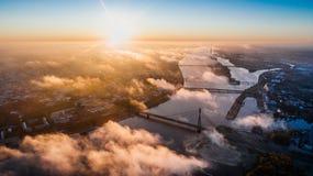 Riga city Autumn sunrise buildings living houses Drone fog ans Daugava river Stock Photography