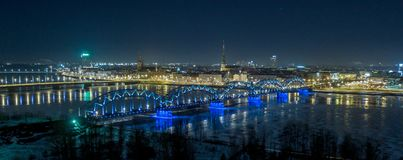 Riga city bridge And Old Town Autumn Drone flight trafics and cars above night stock photo