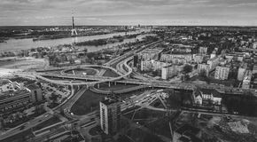 Riga city bridge And Old Town Autumn Drone flight trafics and cars above Night time royalty free stock photos