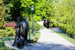 Riga city channel and riveside in spring 2019. Riga river side with statues and pedestrian way in Riga, Latvia.Wonderful day for walk. Lots of green trees and stock photography