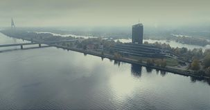 Riga city Old Down Town Autumn Drone Flight TV tower bridges. Riga city Daugava river Autumn Drone Flight island TV tower bridges stock footage