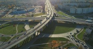 Bridge Viaduct road traffic machine Drone fast time cars in motion. Riga city drone flight above bridge with cars frafics builders in process stock video footage
