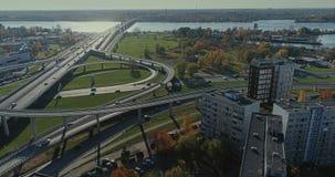 Bridge Viaduct road traffic machine Drone time-lapse. Riga city drone-lapse bridge flight with cars builders in process stock footage