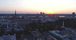 Riga city and evening time sunset Old town Riga Drone flight over Roads and Market. In capital center stock video footage