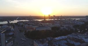 Riga city and evening time sunset Old town Riga Drone flight over Roads and Market. In capital center stock footage