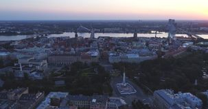 Riga city and evening time sunset Old town Riga Drone flight over Roads and Market. In capital center stock video