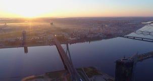 Riga city morning sunrise Old town Riga Drone flight over Roads, Bridge and Daugava river. Cars fraffic stock video footage
