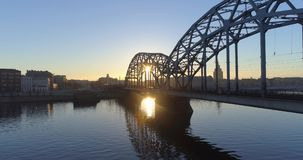 Riga city morning sunrise time Old town Riga Drone flight over Roads and Train Bridge. Blue sky stock video