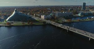 Riga city Old Down Town Autumn Drone Flight TV tower bridges daugava river Library. Riga city Daugava river Autumn Drone Flight island TV tower bridges daugava stock video