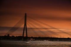 Riga, Daugava bridge at sunset. Bridge over Daugava river at sunset, Riga capital city of Latvia stock image
