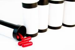 Riga della bottiglia di pillole Immagine Stock Libera da Diritti