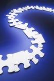 Riga delle parti di puzzle del puzzle fotografia stock