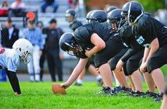 Riga di Scimage di football americano della gioventù Fotografia Stock