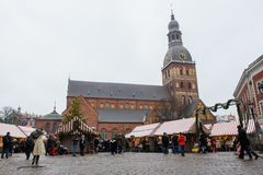 Riga dome church and Christmas bazaar stock photography