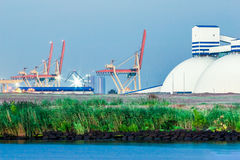 Riga fertilizer terminal. With saltpeter against river coast Royalty Free Stock Photo