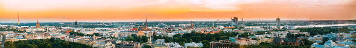 Riga, Latvia. Aerial View Panorama Cityscape At Sunset. TV Tower. Academy Of Sciences, St. Peter`s Church, Boulevard Of Freedom, National Library, Dome Royalty Free Stock Photography